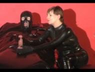 rubber bed femdom handjob